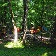 фото курортный отель лесная песня. детская площадка в лесу