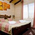 фото Отель ТАОР - Карпаты Сходница. Маленький семейный домик. Кровать